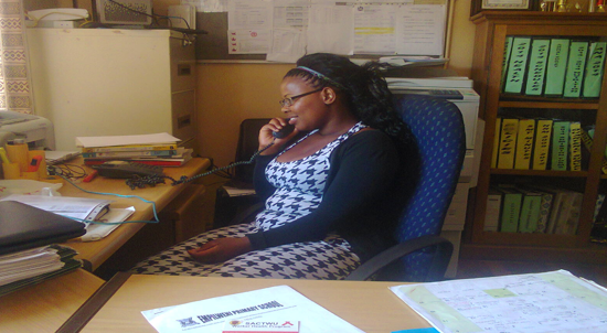 Fikile at her desk